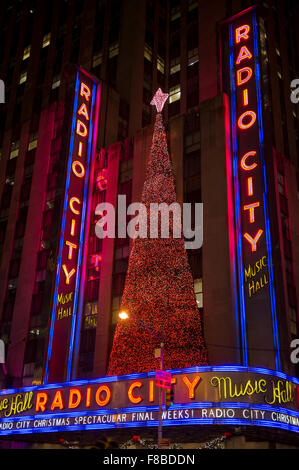 NEW YORK CITY, USA - DECEMBER 27, 2014: Christmas tree decorates the facade of the Radio City Music Hall. - Stock Photo