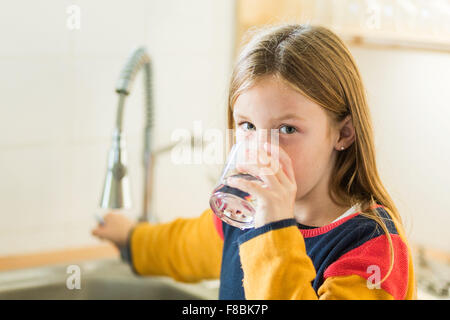 9-year-old girl drinking tap water.