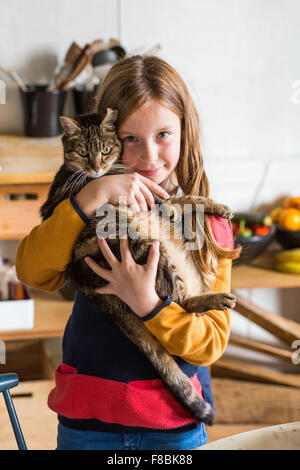 9-year-old girl with a cat. - Stock Photo