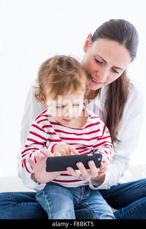 2 year-old boy with cell phone. - Stock Photo