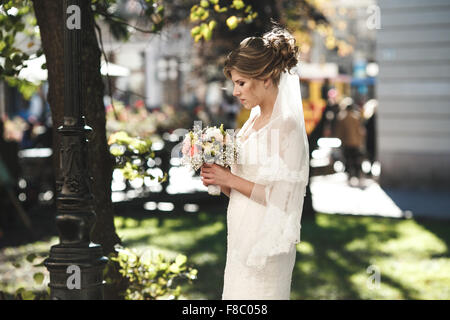 Bride waiting for the groom - Stock Photo