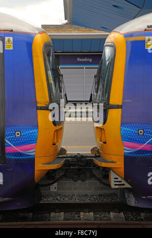 Two coupled 165 Traction units sat in a platform at Reading station, showing the coupling and train fronts painted - Stock Photo