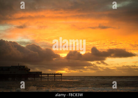 Aberystwyth Wales UK, Tuesday 08 December 2015  Subset over Aberystwyth pier.   Each evening between October and - Stock Photo