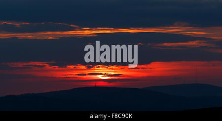 Sunsets behind Kit Hill & Caradon Hill in Cornwall UK - Stock Photo