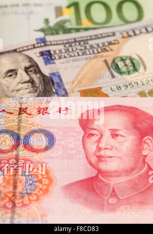 American dollars, European euro and Chinese yuan bills - Stock Photo