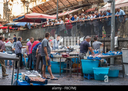 Catania fish market, view of Sicilian people looking at fish for sale on a busy morning in the fish market in Catania, - Stock Photo