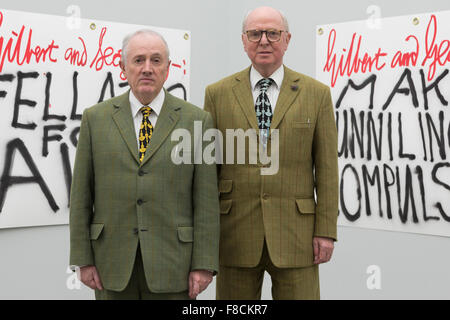 London, UK. 8 December 2015. Pictured: L-R: Gilbert & George in front of their artworks The Banners. Artists Gilbert - Stock Photo