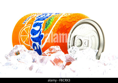Fanta Icy Orange on a bed of ice over white background - Stock Photo