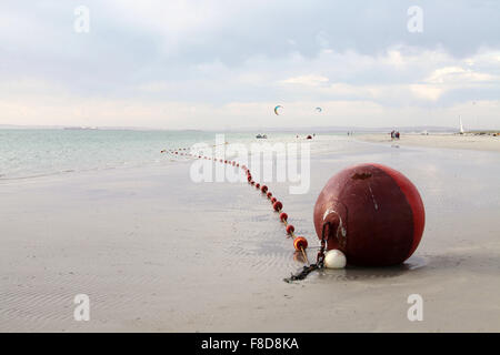 Red Buoy on the shore of Langebaan Lagoon in the Western Cape of South Africa - Stock Photo