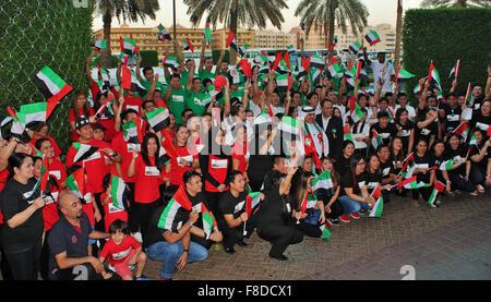 Dubai, United Arab Emirates. 02nd Dec, 2015. Abunader's Group of Company staffs celebrating the 44th UAE National - Stock Photo