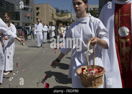 Novosibirsk, Western Siberia, Russia. 7th June, 2015. Young catholic taking part the procession around the Cathedral - Stock Photo