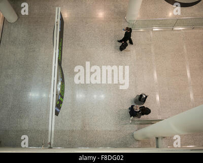 Aerial view passengers exiting Toronto arrival terminal exit. - Stock Photo