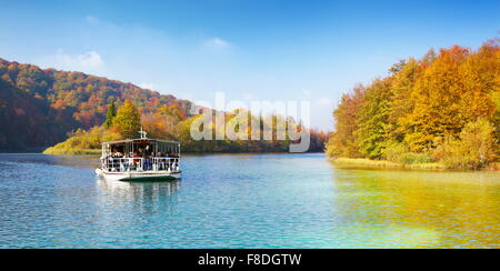 Ferry boat in Plitvice Lakes National Park in autumn, Croatia