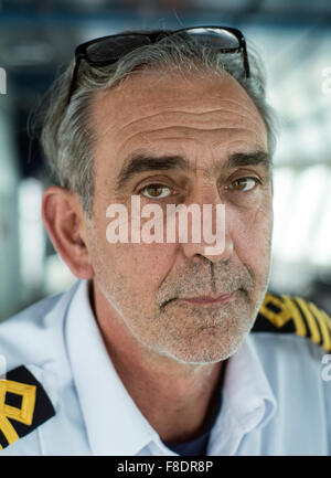The captain of a Canadian shipping vessel, taken in the wheel house of the ship off the Atlantic coast of Quebec, - Stock Photo