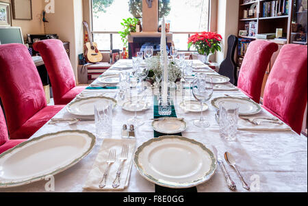 Dining table is set for a holiday dinner - Stock Photo