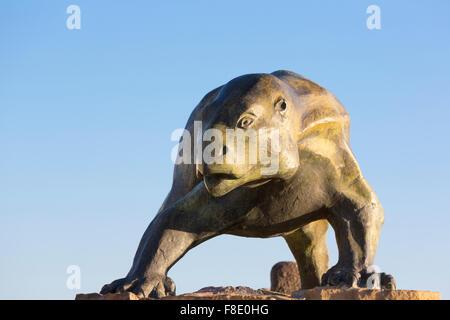 Sculpture of dinosaur against blue sky, Ischigualasto - Stock Photo