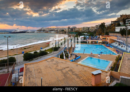View of the municipal swimming pool in Piraeus and mouth of Zea marina, Greece - Stock Photo