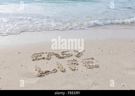 Easy life written out in wet sand - Stock Photo