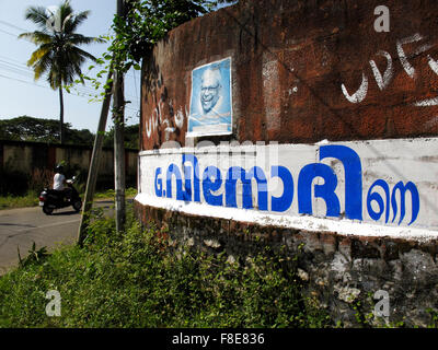 Election candidate poster on a wall in Varkala, Kerala, India - Stock Photo
