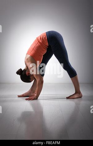Woman stretching in Ashtanga Vinyasa yoga asana - Stock Photo