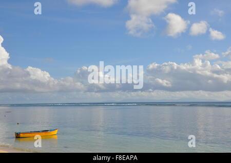 A small dinghy on a tropical beach, seychelles - Stock Photo