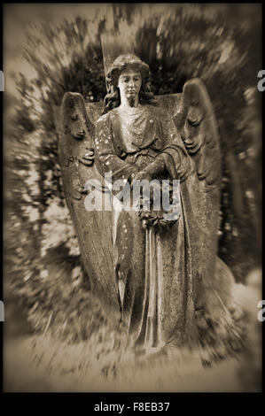 statue of angel in highgate cemetary - Stock Photo