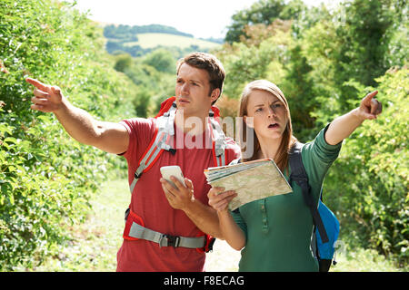 Couple Disagreeing About Best Way To Navigate On Hike - Stock Photo