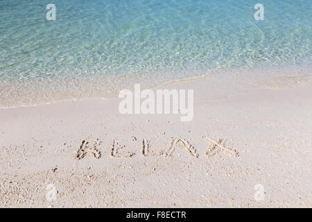 Relax written out in wet sand on a tropical beach in Thailand - Stock Photo