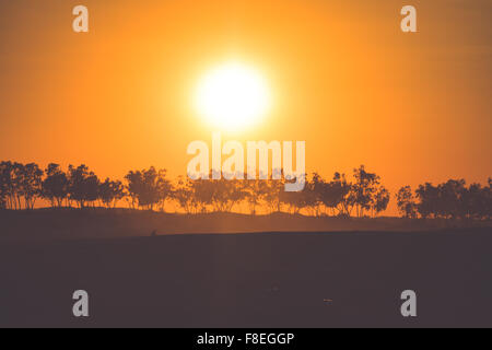 Sunset in the Sahara desert - Douz, Tunisia. - Stock Photo