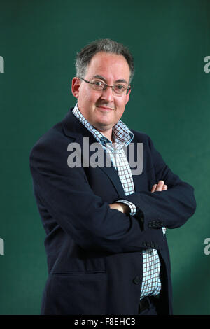 A portrait of Gideon Rachman in Charlotte Square Gardens during The Edinburgh International Book Festival. - Stock Photo