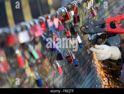Love locks are removed from the security fence on the 'Slinky springs to fame' bridge in Oberhausen, Germany, 09 - Stock Photo