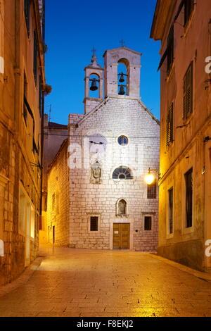 Sibenik, Croatia - Old town street with the Church of Saint Barbara - Stock Photo
