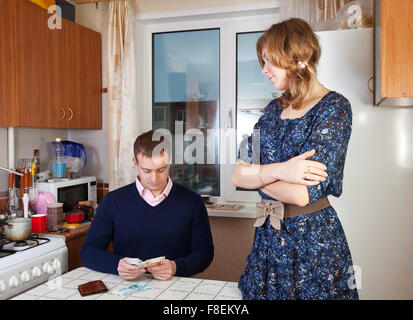 Quarrel in the family due to lack of money - Stock Photo