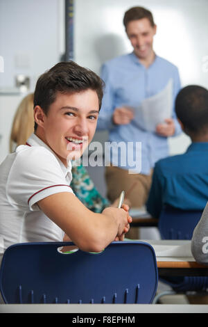 Portrait Of Male Teenage Pupil In Class - Stock Photo
