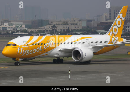 Kaohsiung, Taiwan - October 17, 2015: A Scoot Boeing 787-8 Dreamliner with the registration 9V-OFB taxis at Kaohsiung - Stock Photo