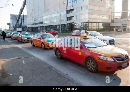 Toronto, Canada. 9th December 2015. Toronto taxi drivers gather to stage a demonstration against Uber taxi service - Stock Photo