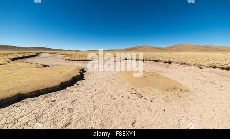 Barren valley, known as 'quebradas', and mountain range of Lipez region on the Andean Highlands, among the most - Stock Photo