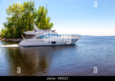 Large luxury motor boat on the Volga River in sunny day - Stock Photo