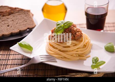Italian spaghetti dressed with Bolognese vegan sauce - Stock Photo