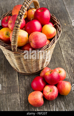 autumn apples in basket on old wooden table Stock Photo