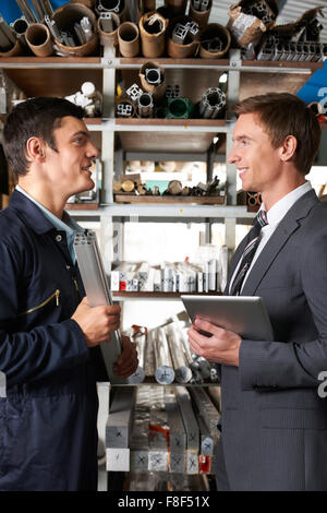 Manager And Worker In Factory Store Room - Stock Photo