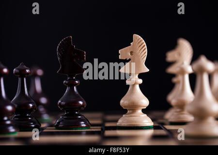 Chess. White pawns vs black on wooden chessboard - Stock Photo