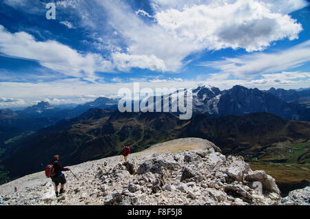Trekkers descending from Piz Boe at the Dolomites, Italy - Stock Photo