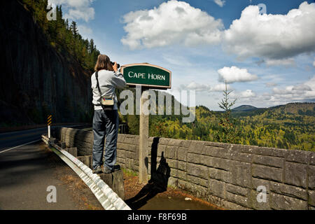 WASHINGTON - Tourist photographing the view east up the Columbia River Gorge to Beacon Rock and beyond from Cape - Stock Photo