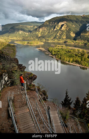 WASHINGTON - Hiker on switchbacking trail up Beacon Rock over looking the Columbia River from Beacon Rock State - Stock Photo