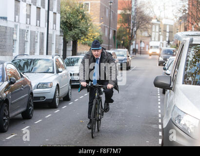 London Mayor and MP for Uxbridge and South Ruislip,Boris Johnson,arrives on his bicycle to speak at a community - Stock Photo