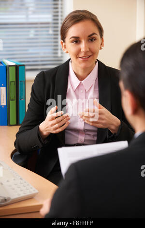 Female Job Applicant Being Interviewed - Stock Photo