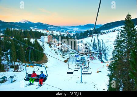 Aerial view from the sky lift on Bukovel - famous Ukrainian ski resort - Stock Photo