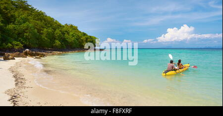 Thailand - Phi Phi Island, Phang Nga Bay, tourists on canoe - Stock Photo