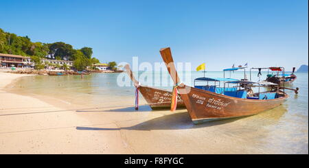 Thailand - Phi Phi Island, Phang Nga Bay, long tail boats on the beach - Stock Photo